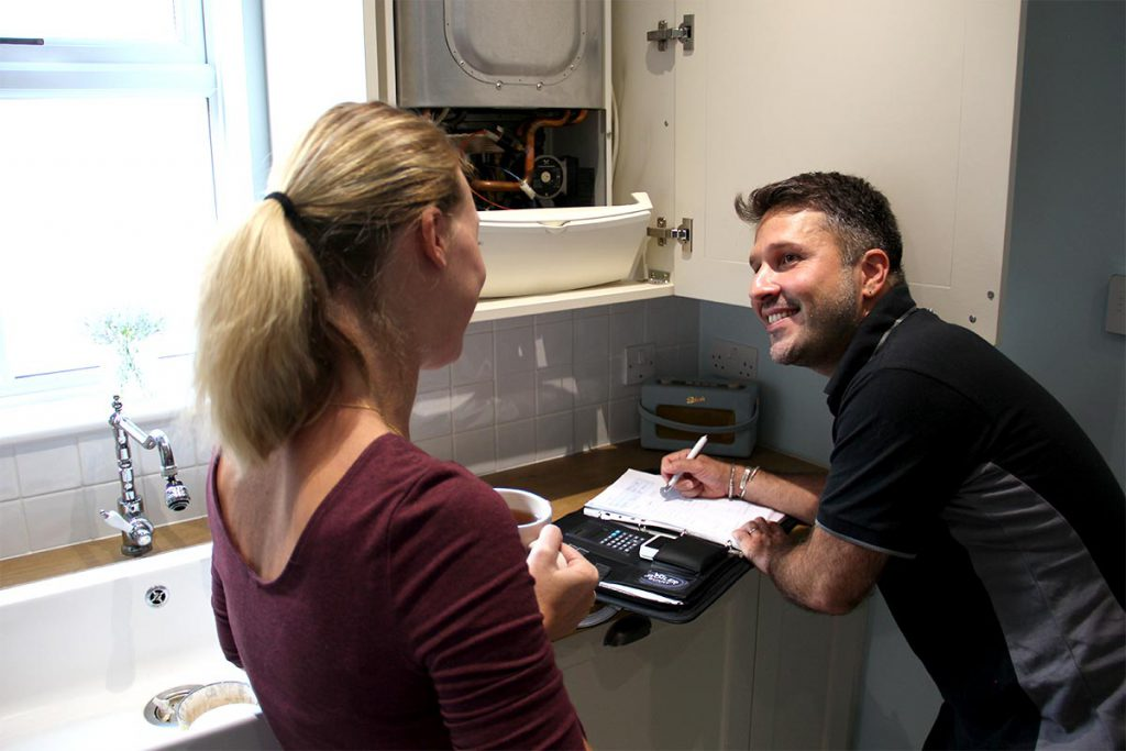An expert boiler service engineer from Boiler Bunny Heating doing a routine gas boiler service in a house in South London - Dulwich, SE21.