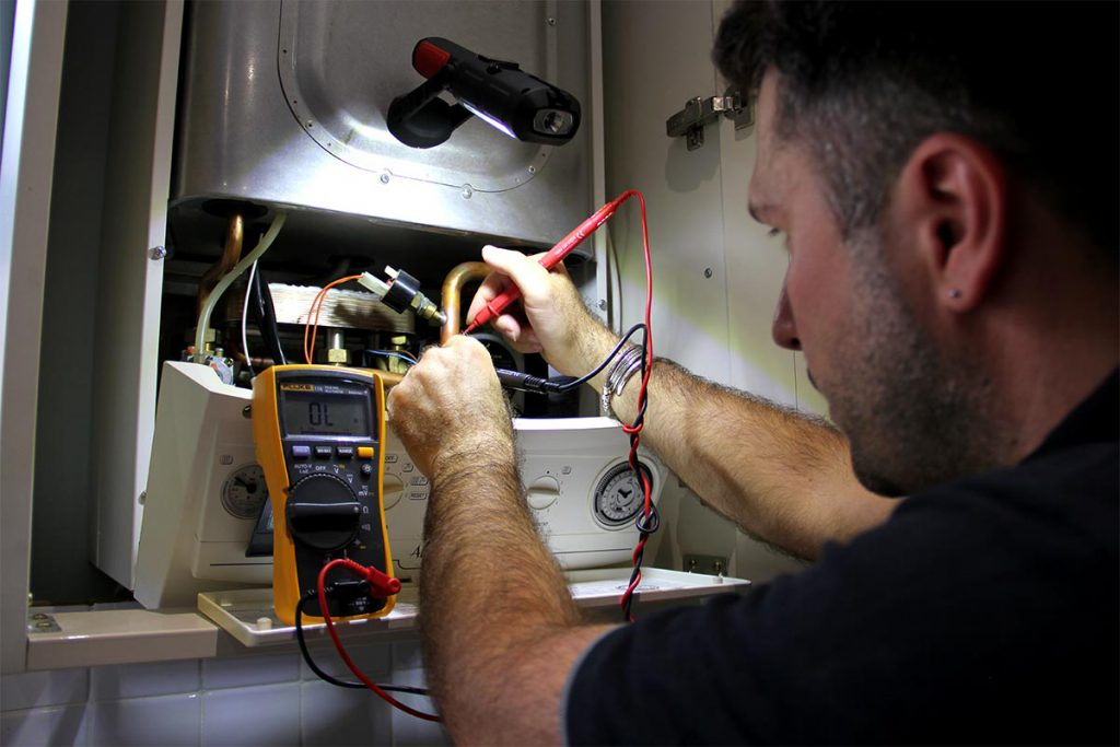 A local, technical heating engineer repairing a Vaillant Ecotec gas boiler during an emergency repair in South East London, Sydenham – SE26.