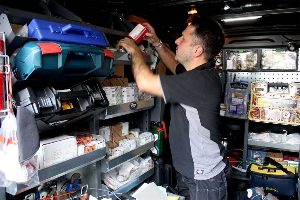 A skilled Boiler Bunny Heating engineer looking through tools in his service van to repair a Vaillant boiler in SE26, South East London.